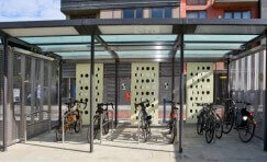 view of Trueform's DLR cycle shelter that has solar powered lighting and CCTV