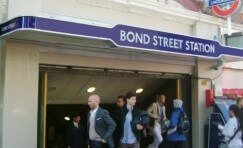 view of the entrance to bond street station with the TfL signage in view.