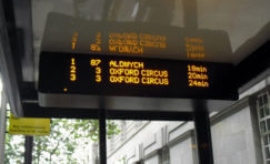 view of a matrix LED display with passenger information on screen.