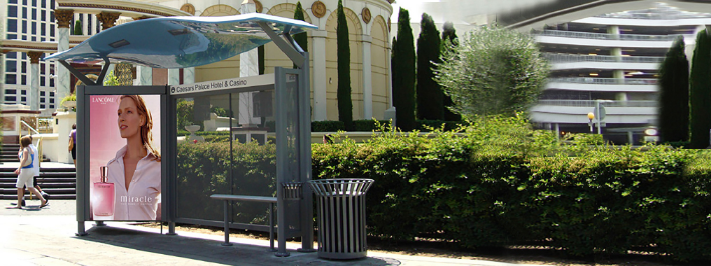 view of a modern waiting shelter with a curved canopy and seating.