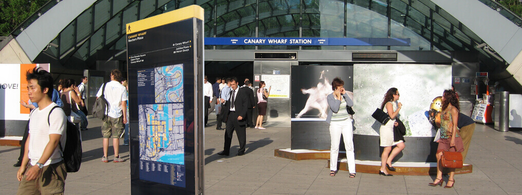 view of a wayfinding digital totem outside of Canary Wharf station.