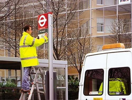 underground sign being installed by a Trueform employee.