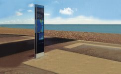 view of installed Portsmouth Legible City wayfinding totem near the sea.