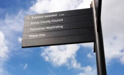 view of installed Surrey Pedestrian wayfinding fingerpost sign.
