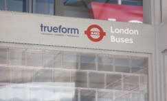 view of sign inside London LEGO bus shelter.