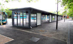 view of large bus shelter at Bletchley Bus Station for multiple buses.