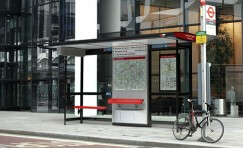 view of installed Landmark London bus shelter with public seating.