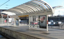 view of Manchester Victoria platform's waiting shelter from the other side of the platform.