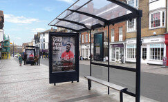 Digital 6 sheet advertising display by a bus shelter.