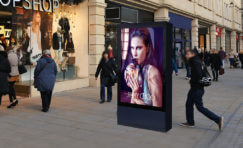 """Double sided 75"""" digital 6 sheet display."""