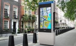 smart media hub totem installed by side of road.