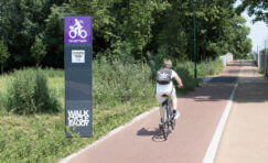 cyclist going past a digital cycle counter.